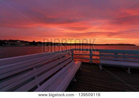 Embankment of sunset on the pier in Sopot near Gdansk Poland.