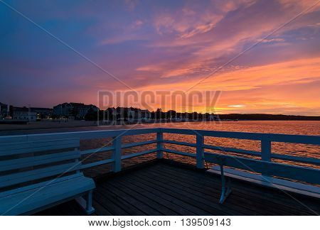 Sunset on the pier in Sopot near Gdansk Poland.