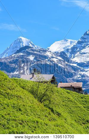Beautiful Swiss mountain valley landscape with a single house.