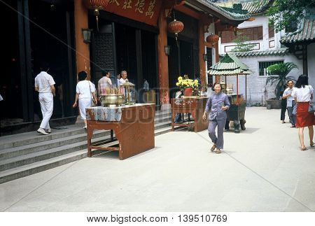 GUANGZHOU / CHINA - CIRCA 1987: Buddhists worship at the Guangxiao Buddhist Temple, also known as the Bright Filial Piety Temple,