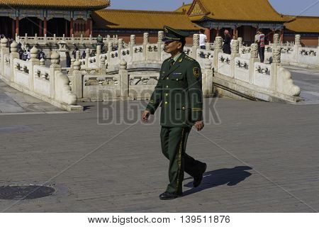 Beijing China April 3 2016 A Soldier Patrols the Grounds of The Forbidden City in Beijing China. Editorial Use Only.