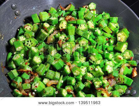Okra or Bhindi fry an Indian stir fry made of onions and red chili pepper.