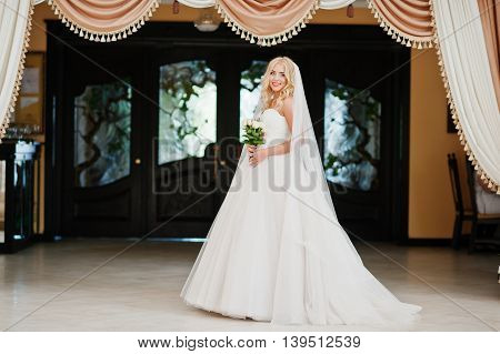 Elegant Blonde Blue Eyes Fashion Bride At Great Wedding Hall Background Curtains