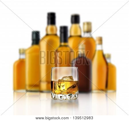 Bottle and glass of whiskey isolated on a white background