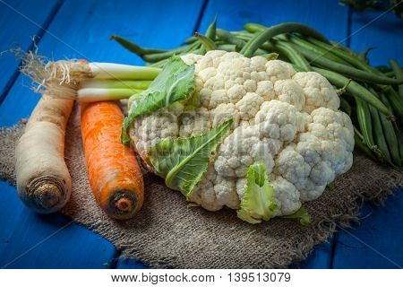 Fresh Vegetables On Blue Table.