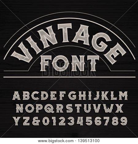 Vintage font. Retro alphabet. Dirty letters on a grunge wooden background. Vector typeface.