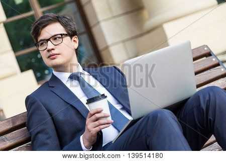 Businessman With Coffee And Laptop