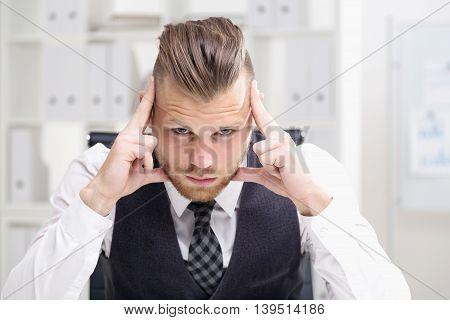 Young Businessman Thinking Looking At Camera