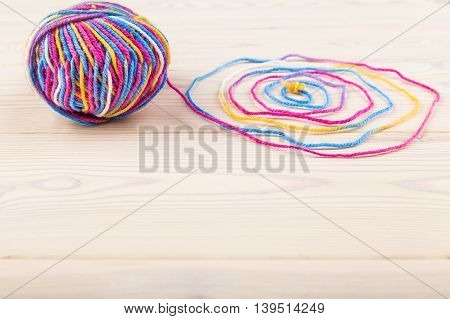 Thread And Bundle On Wooden Table