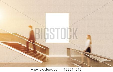 Man and woman climbing staircase in office lobby. Large banner on wall. Concept of working in business building. 3d rendering. Mock up. Toned image