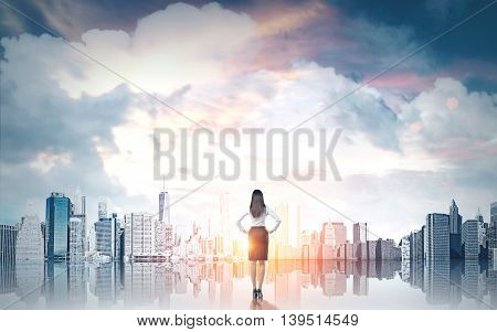 Research concept with businesswoman looking at New York city on sky background with clouds and sunlight