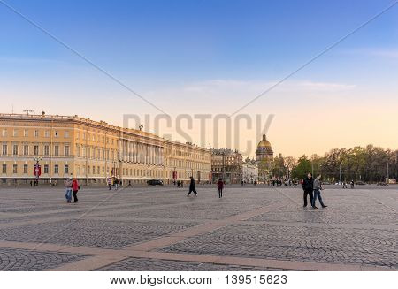 View from the Palace Square St. Isaac's Cathedral and General Staff Building at sunset in Saint Petersburg Russia