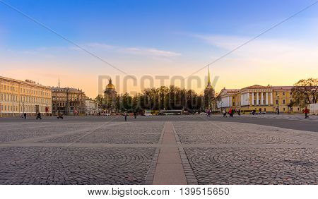 View from the Palace Square St. Isaac's Cathedral and the Admiralty at sunset in Saint Petersburg Russia
