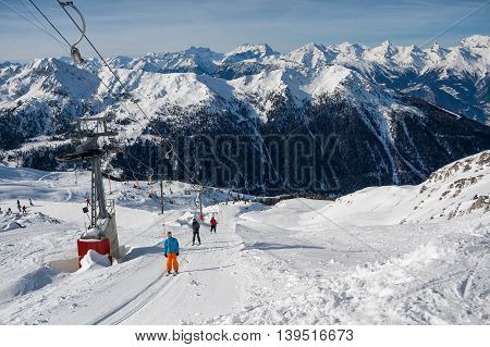 4 VALLEY SWITZERLAND - FEBRUARY 04 2010: Ski resort in the Swiss Alps. Skiers ascend on rope tow up