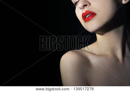 Close up of a young woman with red lips