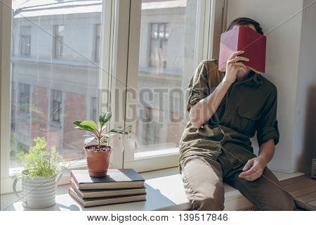 young man rest after reading book before university exam