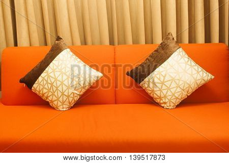 Two pillows on the sofa in living room.