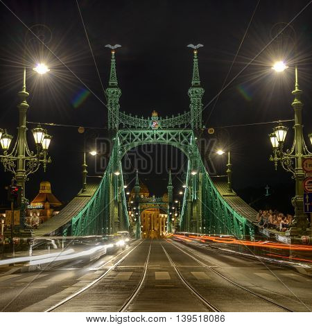 Liberty Bridge at night in Budapest, Hungary.