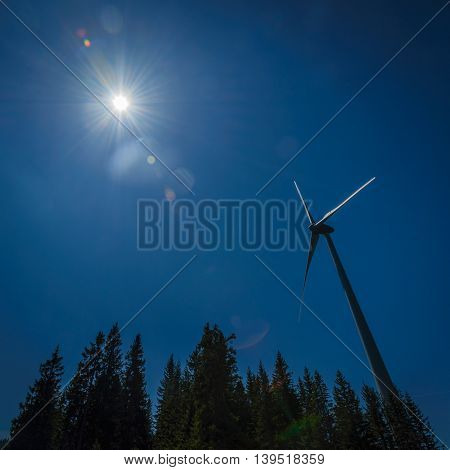 Wind turbine against blue sunny sky.Copy space.