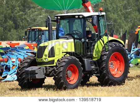 tractors and harvesters in the agricultural fair in Russia