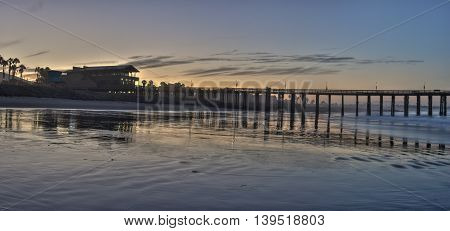 Panoramic view of the Ventura Pier silhouetted against a summer sunrise