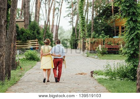 Lovers Hold Hands And Walk In The Park