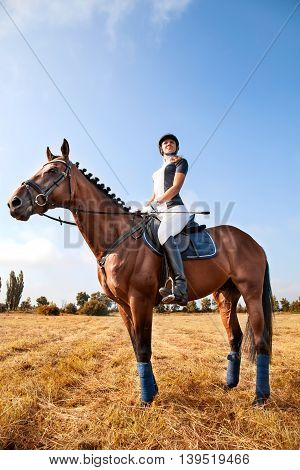 Portrait Of Beautiful Young Horsewoman Sitting On A Horse.