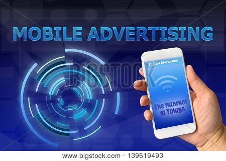 Woman hand holding smartphone against digital blue background THE INTERNET OF THINGS concept