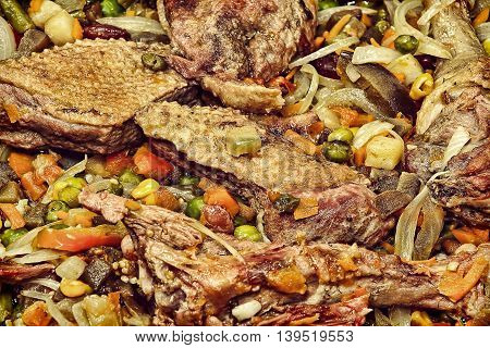 Appetizing roasted meat with vegetables taken closeup.Toned image.