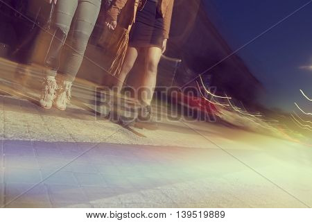 Two girls walking down the city streets ready for a night out with friends