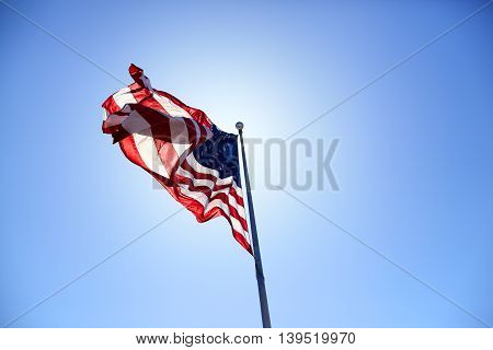 American Flag Blowing Wind On The Blue Sky