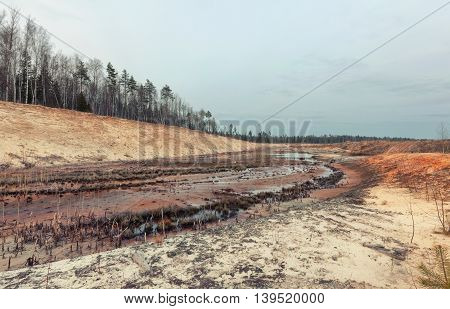 Landscape old waterlogged sand quarry. Environmental pollution