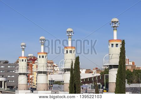 BARCELONA SPAIN - MAY 12 2016 : Towers in Espanya Industrial Park.It is located near Sants train station an area of 4.6 hectares is ideal for family relaxation. A special highlight is a giant dragon - slide for children.