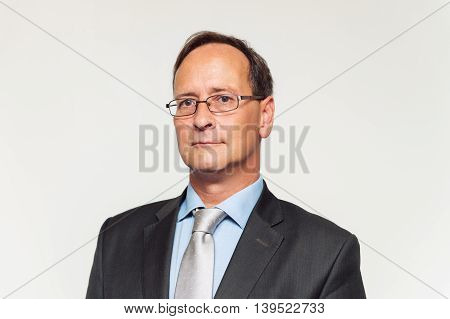 Close up portrait of middle-age man in formalwear