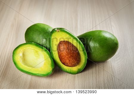 Tropical fruit avocado on a wooden surface