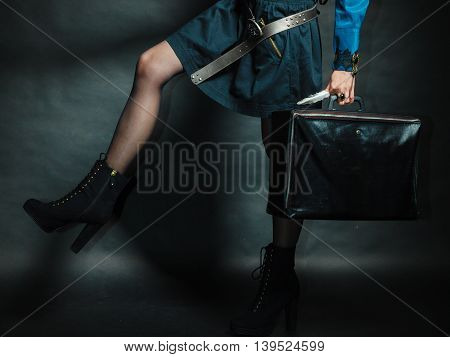 Journey and travel. Retro stylished girl with vintage big bag suitcase valise. Stylish victorian woman on dark background.