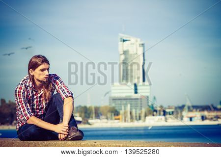 Man Long Hair Relaxing By Seaside