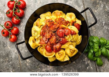 fresh tortelloni with tomato pesto and grilly cherry tomatoes