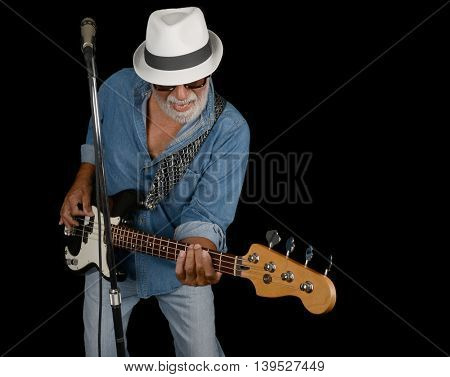 Los Angeles,California USA. july 16th 2016 A dramatic Nice studio Image Of a Senior Bass Player