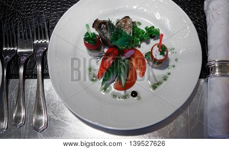 Dish of salad vegetables on a Banquet table covered in crocodile skin. Luxury festive table. Snack food at the festival.