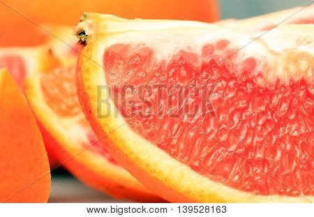 Close up shot of orange pulps, exposing the texture of an orange.
