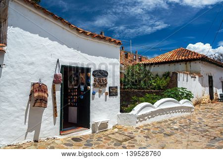 VILLA DE LEYVA COLOMBIA - APRIL 29: Souvenir shop in a white colonial building in Villa de Leyva Colombia on April 29 2016