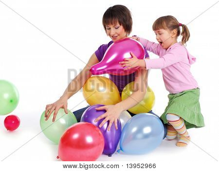 Mother and his  daughter playing colorful balloons. studio shoot over white background