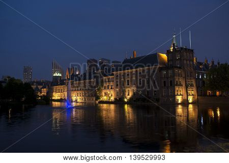 Dutch Parliament Building the Binnenhof and Hofvijver at night in the Hague the Netherlands