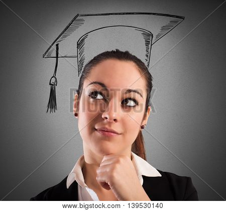 Woman with graduation hat drawn and pensive expression