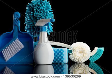 a lot of cleaning tools and black background