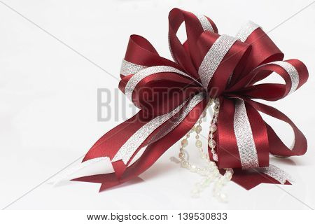 Red bow and ribon on white background .
