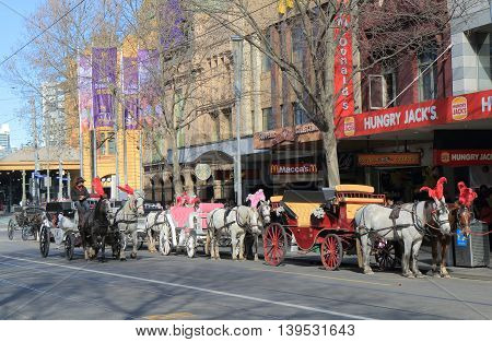 MELBOURNE AUSTRALIA - JULY 16,2016: Horse carriage on Swanston Street Melbourne - Horse carriage is a popular way for sightseeing in Melbourne