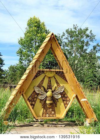 Wooden bee in garden of Niagara Falls Ontario, Canada