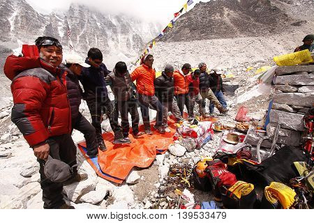 Everest base camp, Nepal - April 13, 2014: Sherpas doing the sherpa dance after Puja ceremony